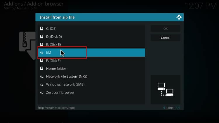Find and select the source name corresponding to the EzzerMac download path on Kodi